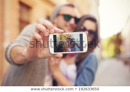 Men on street photographing with smart-phone Stock photo © adamr
