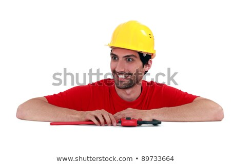 Stock photo: Manic looking manual worker