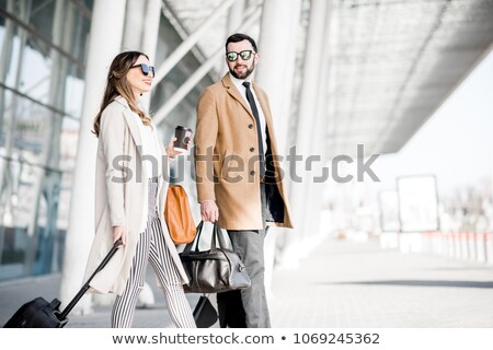 Business couple arriving at airport Stock photo © photography33