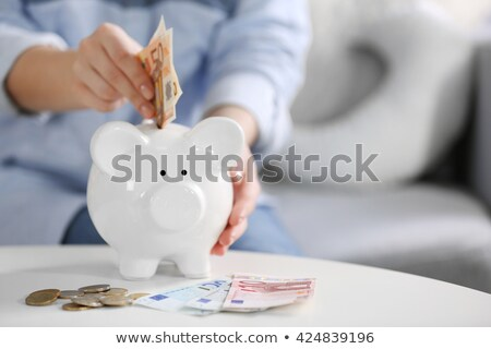 hand put euro in piggy-bank stock photo © shutswis