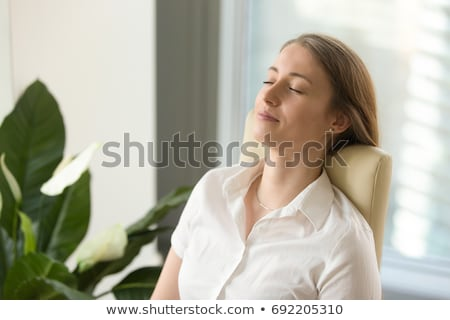 Businesswoman practicing breathing techniques Stock photo © photography33
