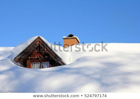 Snow-covered roof with icicles Stock photo © BSANI