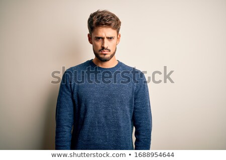 Grumpy young man Stock photo © silent47