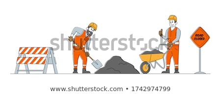 Construction worker using a spade Stock photo © photography33