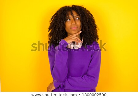 Attractive female posing sideways confidently Stock photo © stockyimages