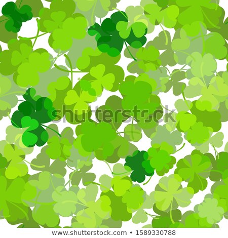 white striped shamrocks in green old paper background Stock photo © marinini