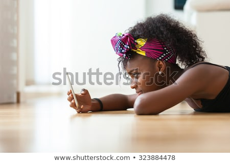 young african american woman talking on a cell phone with a upse stock photo © dacasdo