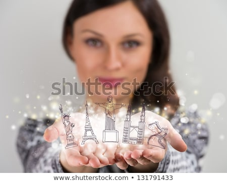 Stock photo: Closeup portrait of woman sharing virtual symbols of famous tour