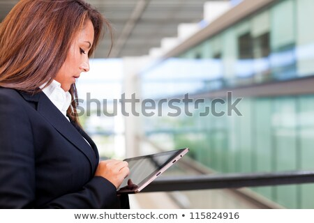 futuristic businesswoman office finger touch pad stock photo © lunamarina