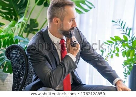 portrait of young business man smoking Stock photo © feedough