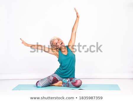 slim woman sitting on a white floor stock photo © nobilior