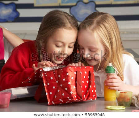 Primary School Pupils Enjoying Packed Lunch In Classroom Stock photo © monkey_business