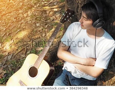 moço · ouvir · música · parque · verde · diversão · dormir - foto stock © deandrobot