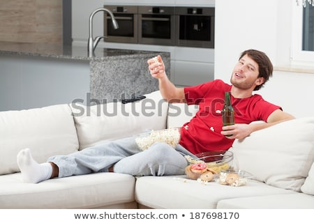 lazy guy couch potato with chips and beer Stock photo © zkruger