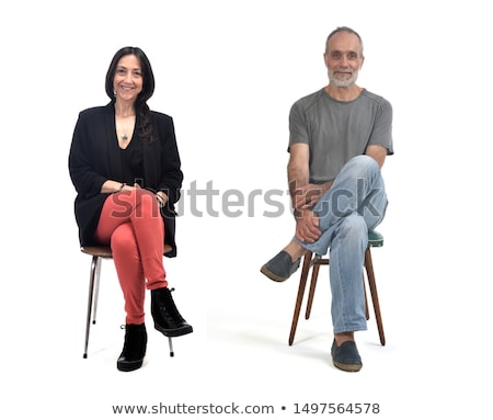 Woman sitting on the chair isolated on white Stock photo © Elnur