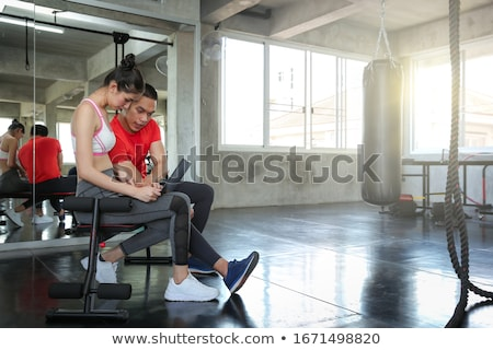 Smiling fitness woman showing laptop screen Stock photo © deandrobot