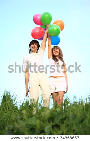 девушки · парень · стоять · трава · многоцветный · шаров - Сток-фото © Paha_L