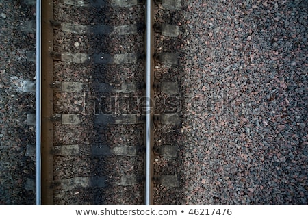 Rails and cross ties of railway among stones at left Stock photo © Paha_L