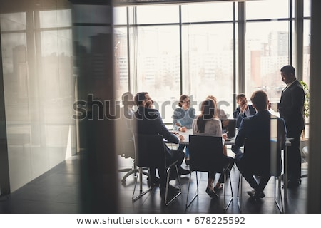 Multiethnic group of young people brainstorming on business meeting  Stock photo © deandrobot