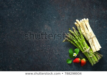 Fresh green and white asparagus on a slate background Stock photo © Zerbor