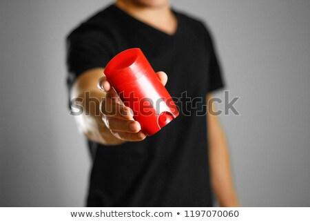 Smiling handsome man holding deodorant Stock photo © deandrobot