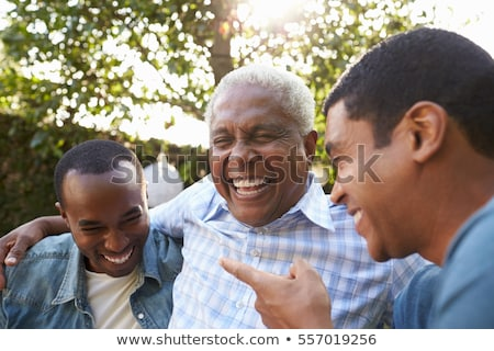 Happy seniors with arms around each other Stock photo © ozgur