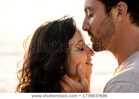 Young man kissing girlfriend forehead at beach Stock photo © wavebreak_media