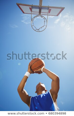 directly below shot of teenage boy playing basketball stock photo © wavebreak_media
