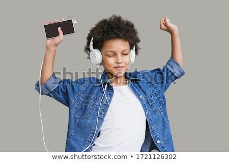 moderne · tienermeisje · dansen · geïsoleerd · witte · muziek - stockfoto © wavebreak_media