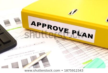 Yellow Office Folder with Inscription Approved. Stock photo © tashatuvango
