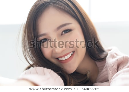 Attractive young asian woman in sweater Stock photo © deandrobot