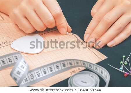 paper pattern attached with sewing pin to cloth Stock photo © dolgachov