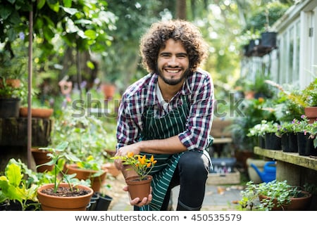 Man in garden holding plants Stock photo © IS2