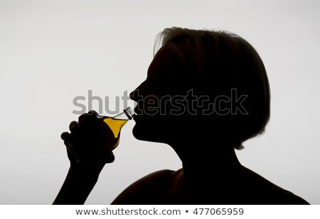 Silhouette of an alcoholic woman with a bottle Stock photo © CsDeli