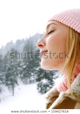 woman in hat eyes closedrelaxed stock photo © is2
