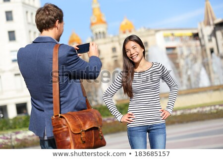 Man taking picture in city square Stock photo © IS2