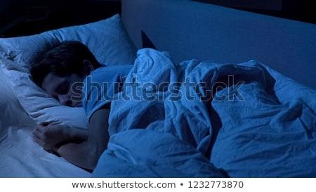 Tizenéves fiú alszik fiatalság hálószoba kaukázusi pihenés Stock fotó © IS2