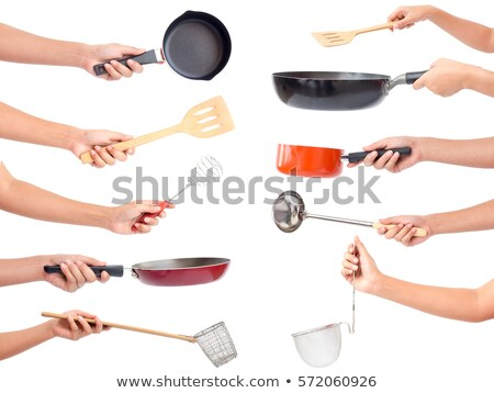 A Chef holding a kitchen utensil Stock photo © bluering