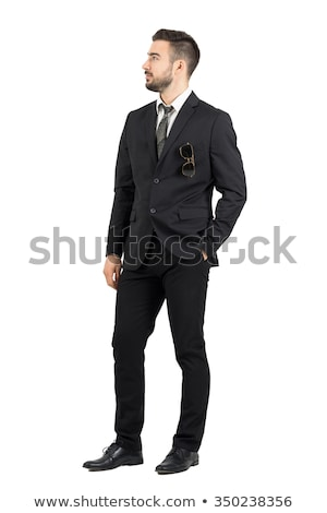 elegant man with hands in pockets looks up to side stock photo © feedough