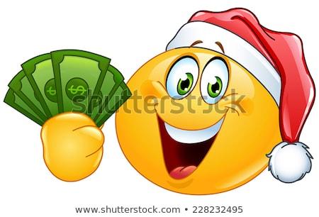 emoticon with santa hat and dollars stock photo © yayayoyo