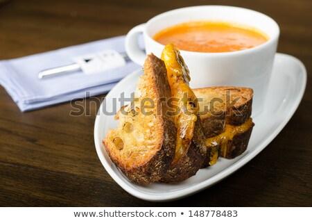 Tomato soup in bowl with crisp bread Stock photo © dash