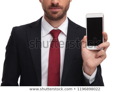 close up of body of businessman presenting mobile phone Stock photo © feedough