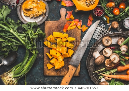 Green Pumpkin and ingredients for tasty vegetarian cooking stock photo © artsvitlyna