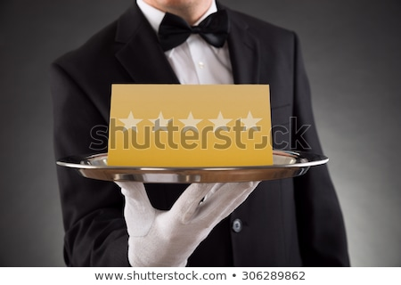Waiter Holding Plate With Five Star Rating Stock photo © AndreyPopov