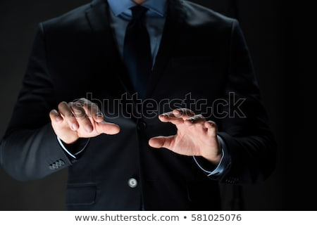 Közelkép üzletember valami láthatatlan üzletemberek virtuális Stock fotó © dolgachov