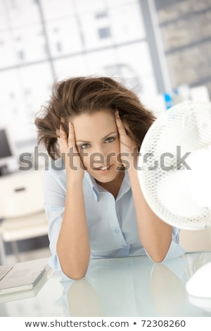 Woman Cooling Herself In Front Of Fan Stock photo © AndreyPopov
