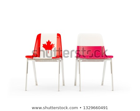 Two chairs with flags of Canada and poland Stock photo © MikhailMishchenko