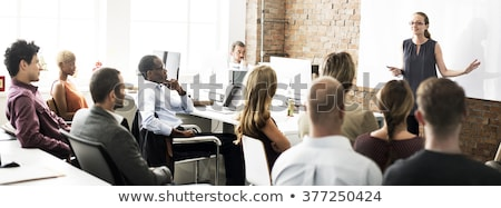 presenters on business seminar with whiteboard foto stock © robuart