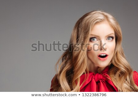 Portrait of beautiful young girl in red blouse with big bow. Stock photo © studiolucky