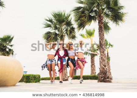 friends in sunglasses having fun on venice beach Stock photo © dolgachov